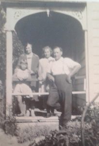 Alexander and family outside their home in Horitiu - Adams Family Collection.