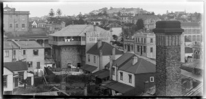 Looking east south east from the Banks Box Building in Wakefield Street showing Wakefield Street (diagonal far right), Langford Brothers, grocers (far right), Mrs E G Dawson boarding house on the corner of Lyndock Street (centre right), Globe Hotel (centre), Mount Eden (far right distance) - Sir George Grey Special Collections.