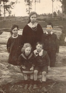 Back row left: Eileen, Unknown, Len with the twins Milicent and Monty in the front - Adams Family Collection.